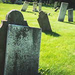 Afternoon light on crokked grave stones in an old graveyard