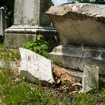 Broken and abandoned gravestones in Rochester New York. Hebrew writing on the stone